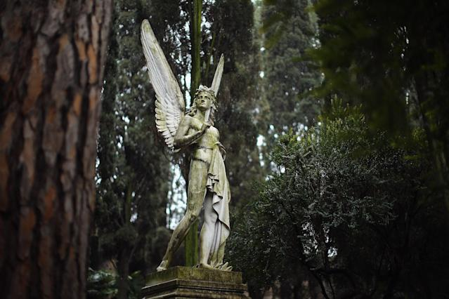 ROME, ITALY - MARCH 26: The 'Angel of the Resurrection' for prominent American sculptor Franklin Simmons, and his wife Ella, stands in Rome's 'Non Catholic Cemetery' on March 26, 2013 in Rome, Italy. Rome's Non-Catholic Cemetery contains one of the highest densities of famous and important graves anywhere in the world including John Keats, one of England's most famous poets, who died early in 1820 of tuberculosis aged 25, after travelling to Italy in search of a better climate to help cure him of the disease. As well as being the final resting-place of the poets Percy Shelley and John Keats, it is also home to graves of many other painters, sculptors and authors who died in Rome. The cemetery which began it's use in 1730 continues today, containing graves of Orthodox Christians, Jews, Muslims and other non-Christians, and is one of the oldest burial grounds in Europe. (Photo by Dan Kitwood/Getty Images)