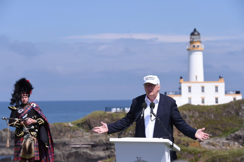 FILE PHOTO: Republican presidential candidate Donald Trump speaks during a news conference, in front of the lighthouse, at his Turnberry golf course, in Turnberry