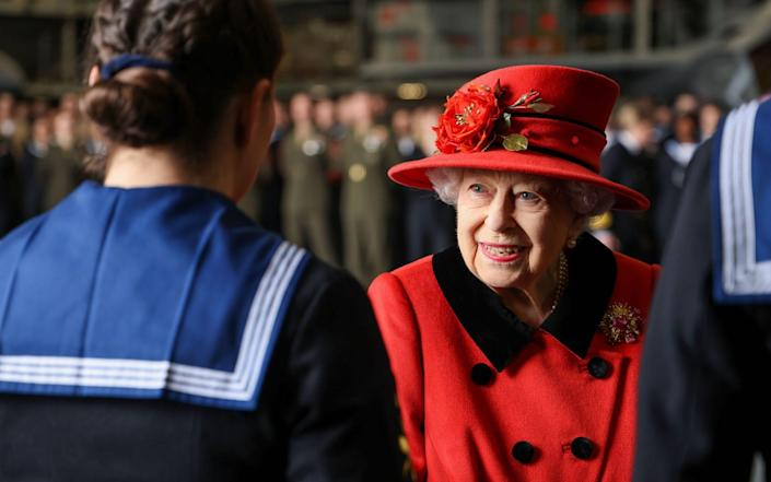 The Queen met with members of the ship's company as she visited the Royal Navy aircraft carrier in Portsmouth just hours before the UK Carrier Strike Group sailed. May 22, 2021. - Jay Allen/Royal Navy/MOD/HANDOUT/EPA-EFE/Shutterstock