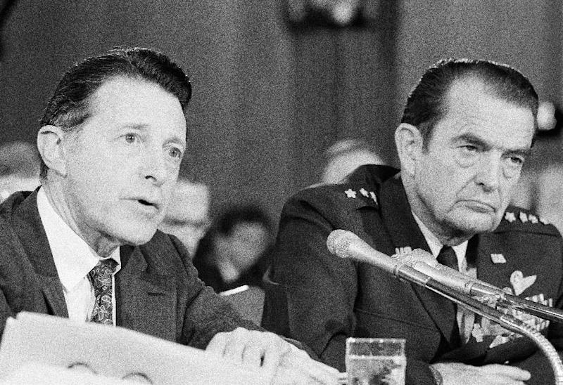 FILE - Secretary of Defense Caspar Weinberger, left, and Air Force Gen. David Jones, chairman of the Joints Chiefs of Staff appear before the Senate Foreign Relations Committee on Capitol Hill in Washington in this Thursday, Oct. 2, 1981 file photo. Jones, a retired Air Force general who helped set in motion a far-reaching reorganization of the U.S. military command while serving as chairman of the Joint Chiefs of Staff, has died at 92. The general's son, David Curtis Jones, said Wednesday Aug. 14, 2013 that his father died Saturday at a military retirement community in Potomac Falls, Va. He had Parkinson's disease. (AP Photo/ Ira Schwarz, File)