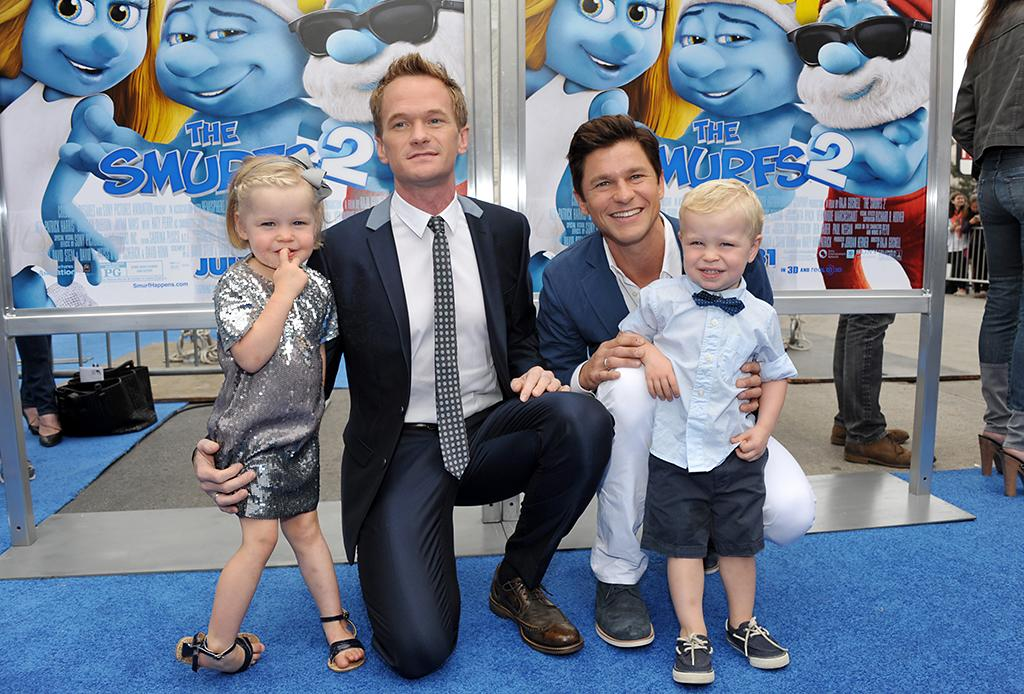 "Neil Patrick Harris and David Burtka with twins Harper Grace Burtka-Harris, left, and Gideon Scott Burtka-Harris, right, arrive to the world premiere of ""The Smurfs 2"" at the Regency Village Theatre on Sunday, July 28, 2013 in Los Angeles. (Photo by John Shearer/Invision/AP)"