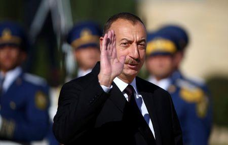 Azerbaijan's President Ilham Aliyev waves during a meeting with Pope Francis at the Presidential Palace in Ganjlik