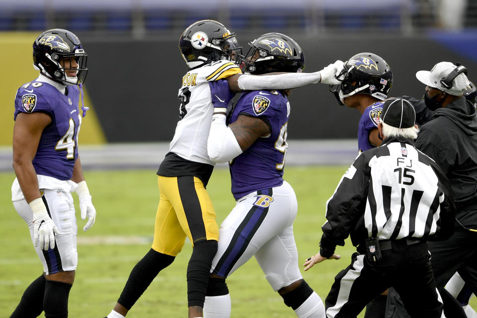 Baltimore Ravens outside linebacker Matt Judon, center, pushes Pittsburgh Steelers wide receiver Diontae Johnson, center left, away during an altercation with Ravens cornerback Marcus Peters, center right, during the first half of an NFL football game, Sunday, Nov. 1, 2020, in Baltimore. (AP Photo/Nick Wass)