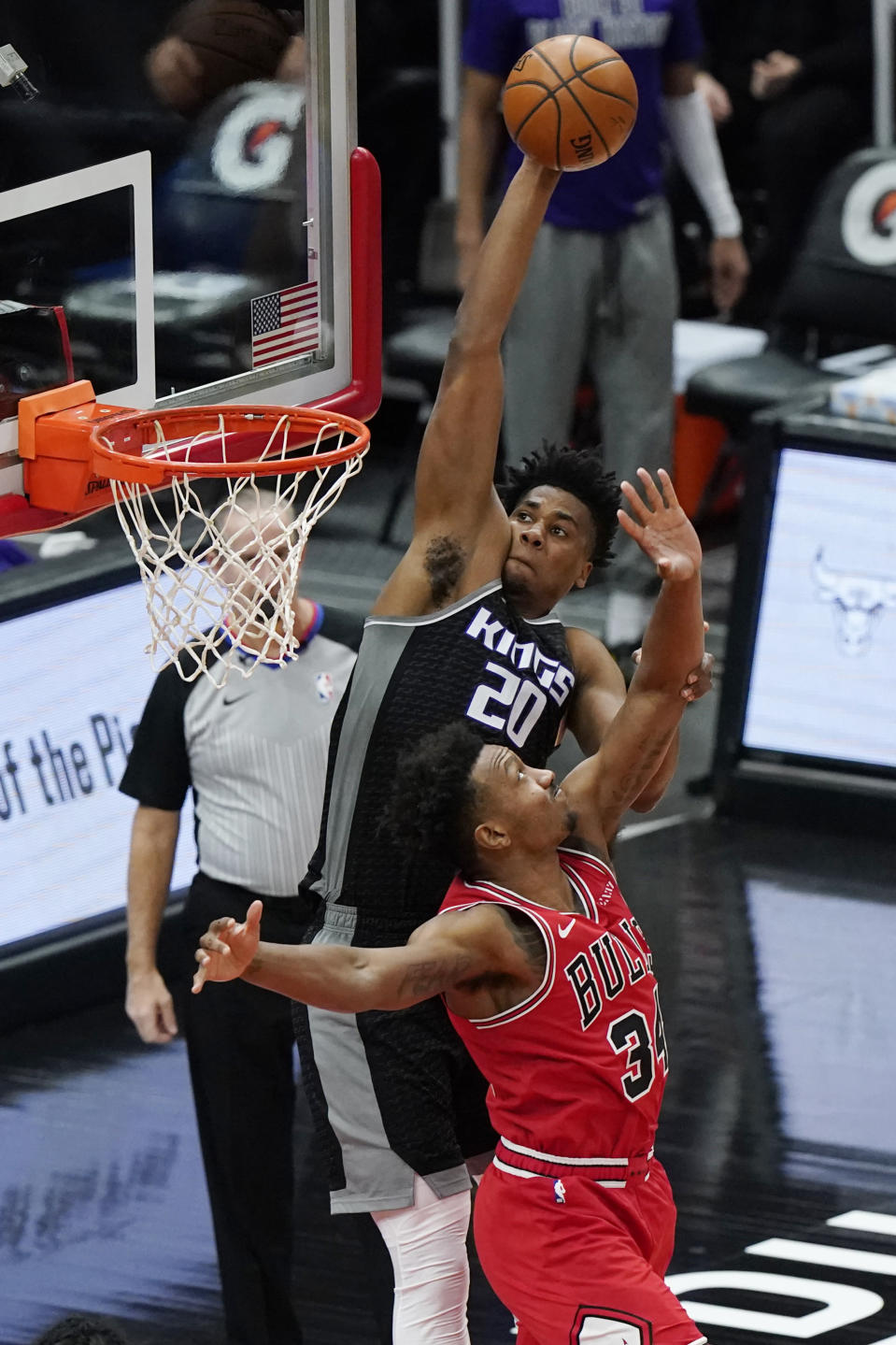 Sacramento Kings center Hassan Whiteside, top, goes up for a dunk against Chicago Bulls center Wendell Carter Jr., during the first half of an NBA basketball game in Chicago, Saturday, Feb. 20, 2021. (AP Photo/Nam Y. Huh)
