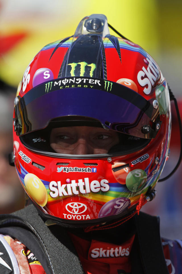 Driver Kyle Busch (18) waits during practice for the NASCAR Sprint Cup series auto race at Bristol Motor Speedway on Friday, March 14, 2014, in Bristol, Tenn. (AP Photo/Wade Payne)
