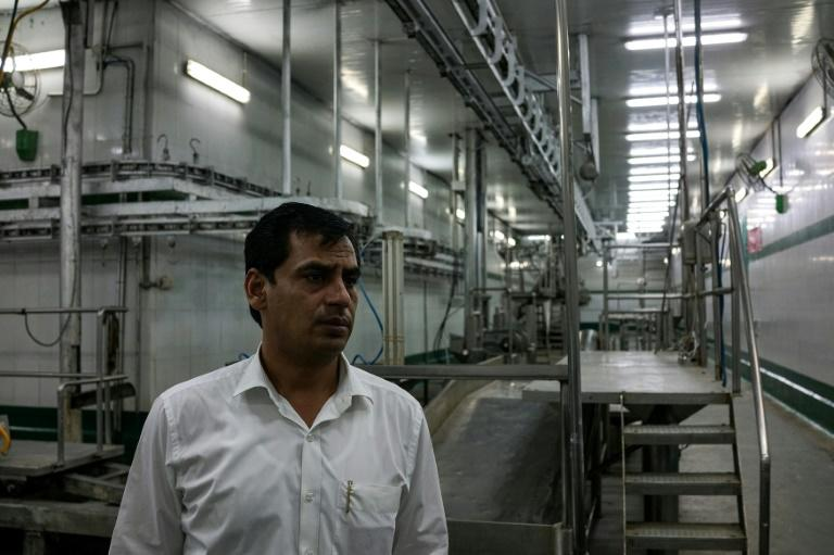 Haji Shadab, the managing director of a slaughterhouse, looks on inside the empty abattoir in Meerut, India