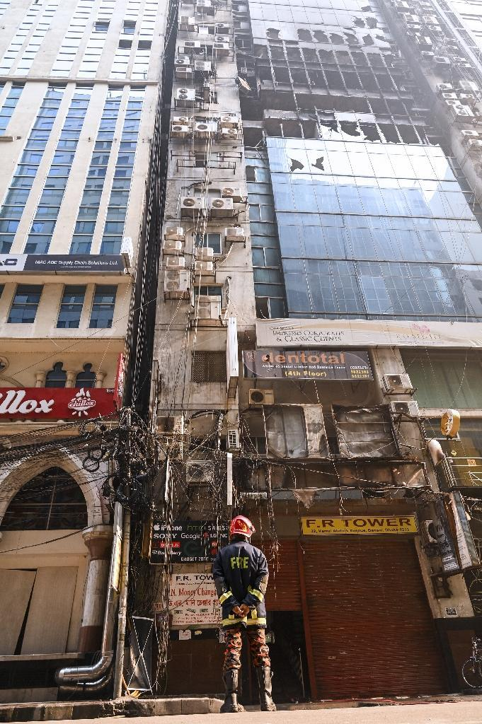 Fire department director Shakil Newaj said they had previously warned the FR Tower management to improve fire safety standards (AFP Photo/MUNIR UZ ZAMAN)