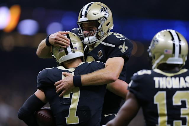 Drew Brees celebrates a touchdown pass with Taysom Hill. (Getty Images)