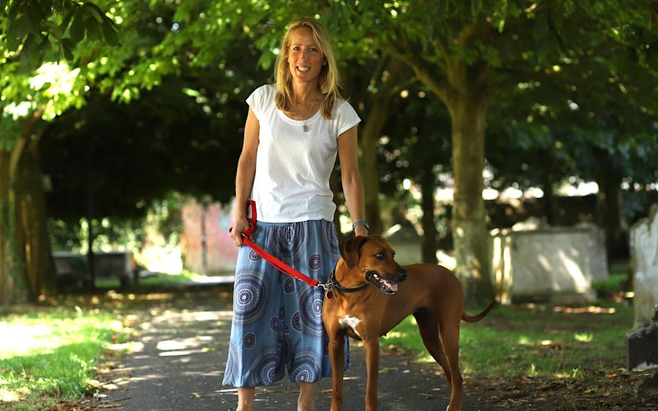 Abigail Butcher photographed with her dog Thala at their home in Lymington, Hampshire - John Lawrence