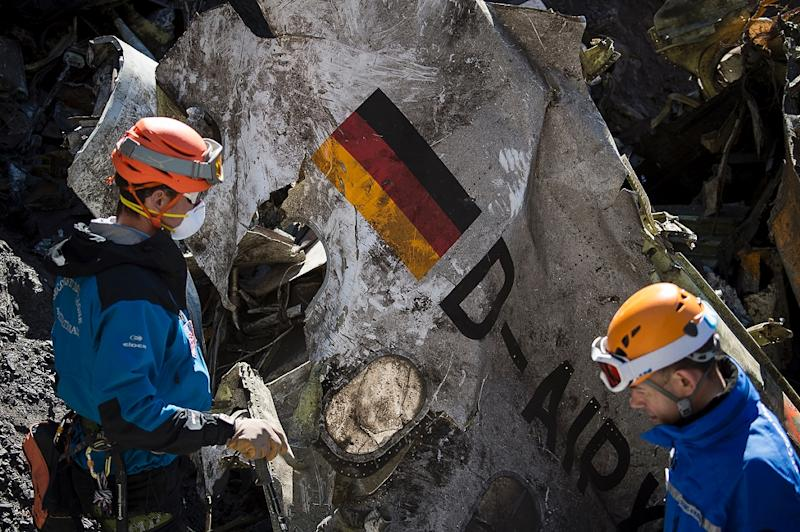 French rescue workers inspect the crash site of the doomed Germanwings flight which smashed in the French Alps on March 24, killing all 150 people on board (AFP Photo/Yves Malenfer)