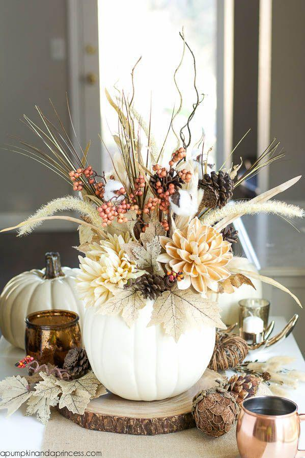 "<p>The arrangement of pinecones, branches, and burlap leaves inside this white pumpkin borders both rustic and elegant.</p><p><em><a href=""http://apumpkinandaprincess.com/2015/09/diy-pumpkin-vase.html"" rel=""nofollow noopener"" target=""_blank"" data-ylk=""slk:Get the tutorial at A Pumpkin and a Princess »"" class=""link rapid-noclick-resp"">Get the tutorial at A Pumpkin and a Princess »</a></em></p>"