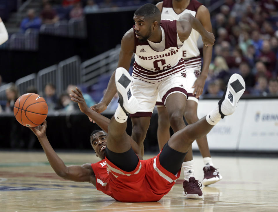 Bradley's Luqman Lundy, bottom, tries to pass as Missouri State's Josh Webster defends during the first half of an NCAA college basketball game in the quarterfinal round of the Missouri Valley Conference tournament, Friday, March 8, 2019, in St. Louis. (AP Photo/Jeff Roberson)