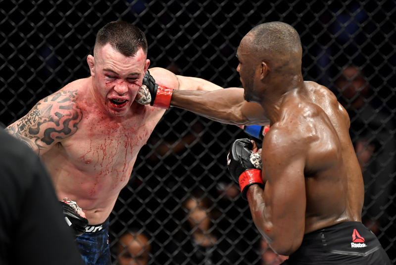 LAS VEGAS, NEVADA - DECEMBER 14: (R-L) Kamaru Usman of Nigeria punches Colby Covington in their UFC welterweight championship bout during the UFC 245 event at T-Mobile Arena on December 14, 2019 in Las Vegas, Nevada. (Photo by Jeff Bottari/Zuffa LLC via Getty Images)