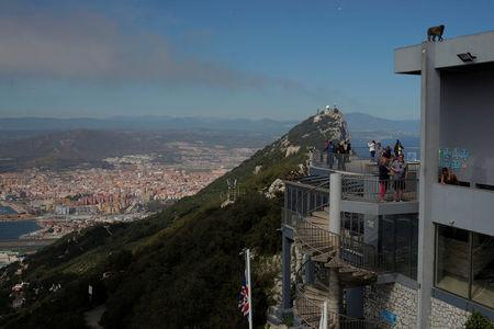 Tourists stand at a terrace on the top of the Rock in the British overseas territory of Gibraltar