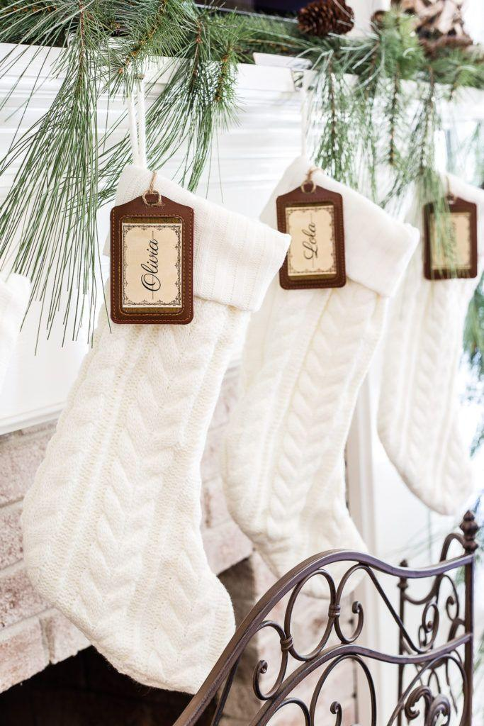 """<p>Create your own custom stockings by tying on tags. Here, inexpensive luggage tags are cleverly repurposed as markers.</p><p><strong>Get the tutorial at <a href=""""https://www.blesserhouse.com/seasonal-simplicity-christmas-living-room/"""" rel=""""nofollow noopener"""" target=""""_blank"""" data-ylk=""""slk:Bless'er House"""" class=""""link rapid-noclick-resp"""">Bless'er House</a>.</strong></p><p><a class=""""link rapid-noclick-resp"""" href=""""https://www.amazon.com/Travelambo-Genuine-Leather-Luggage-Classic/dp/B07BVVRW9C/?tag=syn-yahoo-20&ascsubtag=%5Bartid%7C10050.g.1407%5Bsrc%7Cyahoo-us"""" rel=""""nofollow noopener"""" target=""""_blank"""" data-ylk=""""slk:SHOP LUGGAGE TAGS"""">SHOP LUGGAGE TAGS</a></p>"""