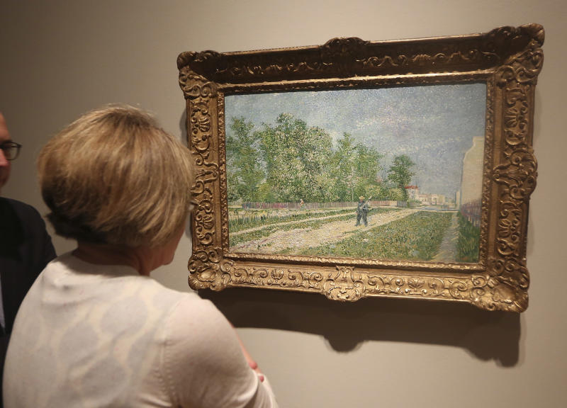 """A painting by Vincent van Gogh is viewed during a press preview of the exhibit """"Hotel Texas: An Art Exhibition for the President and Mrs. John F. Kennedy,"""" during a press preview at the Dallas Museum of Art Wednesday, May 22, 2013, in Dallas. (AP Photo/LM Otero)"""