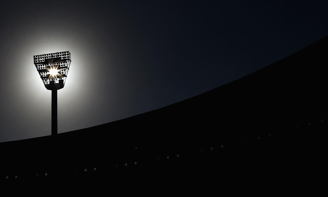 MELBOURNE, AUSTRALIA - DECEMBER 26: The sun rises over the MCG  during day one of the Second Test match between Australia and Sri Lanka at the Melbourne Cricket Ground on December 26, 2012 in Melbourne, Australia.  (Photo by Ryan Pierse/Getty Images)