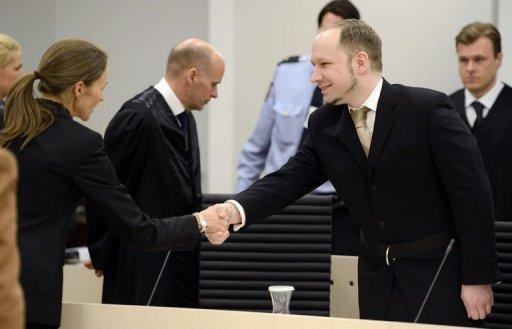 Rightwing extremist Anders Behring Breivik, who killed 77 people in twin attacks in Norway last year, greets pshyciatrist Synne Soerheim (L) in Oslo district courtroom at the start of his trial