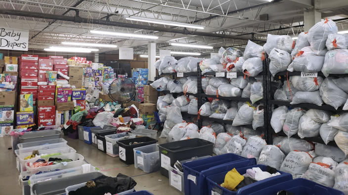 In this October 2019 photo provided by Daniela Dominguez, supplies donated from across the United States for migrants and asylum seekers are stored in a warehouse in McAllen, Tex. Dominguez, assistant professor in counseling psychology at University of San Francisco, said mutual aid networks are part of the Latino culture where people may feel safer getting help from their own community rather than government entities or formal charities. (Daniela Dominguez via AP)