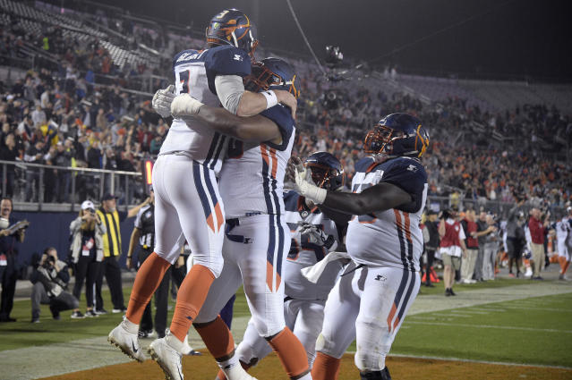 "Orlando Apollos quarterback <a class=""link rapid-noclick-resp"" href=""/nfl/players/27742/"" data-ylk=""slk:Garrett Gilbert"">Garrett Gilbert</a>, left, is congratulated by teammates after catching a pass from receiver Jalin Marshall for a 5-yard touchdown during the first half of an Alliance of American Football game against the Atlanta Legends earlier this month. (AP)"