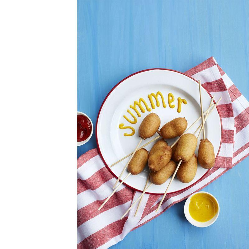 """<p>These classic carnival-style bites are the perfect party appetizer.</p><p><a href=""""https://www.womansday.com/food-recipes/food-drinks/recipes/a55352/corn-pups-recipe/"""" rel=""""nofollow noopener"""" target=""""_blank"""" data-ylk=""""slk:Get the Corn Pups recipe."""" class=""""link rapid-noclick-resp""""><em>Get the Corn Pups recipe.</em></a></p>"""