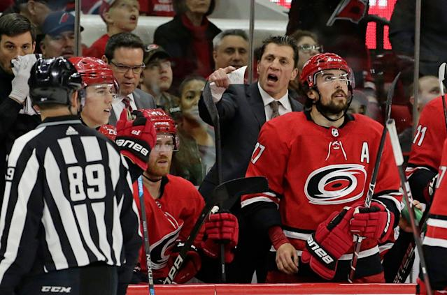 Carolina Hurricanes coach Rod Brind'Amour argues with an official during the second period of an NHL hockey game against the New Jersey Devils in Raleigh, N.C., Thursday, April 4, 2019. (AP Photo/Gerry Broome)