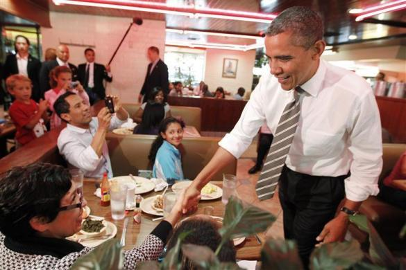 President Barack Obama greets diners at Roscoe's House of Chicken and Waffles in Los Angeles October 24, 2011.