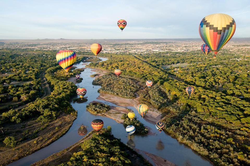 """There's a reason <a href=""""https://www.cntraveler.com/story/how-i-stumbled-upon-new-mexicos-stunning-chaco-canyon?mbid=synd_yahoo_rss"""" rel=""""nofollow noopener"""" target=""""_blank"""" data-ylk=""""slk:New Mexico"""" class=""""link rapid-noclick-resp"""">New Mexico</a> is known as the """"Land of Enchantment."""" It's one of the best family vacation spots in the U.S. because it's an ideal year-round destination, but also because there's something to suit every preference. And Albuquerque, with its easy access to national parks like White Sands and Carlsbad Caverns, and unmatched mountain views, also offers plenty of opportunities for education: Stop in at the <a href=""""https://www.cabq.gov/culturalservices/albuquerque-museum"""" rel=""""nofollow noopener"""" target=""""_blank"""" data-ylk=""""slk:Albuquerque Museum"""" class=""""link rapid-noclick-resp"""">Albuquerque Museum</a>, where the Only in Albuquerque exhibit traces the story of the city through local artifacts, or, when it reopens after COVID-19, the <a href=""""https://indianpueblo.org/"""" rel=""""nofollow noopener"""" target=""""_blank"""" data-ylk=""""slk:Indian Pueblo Cultural Center"""" class=""""link rapid-noclick-resp"""">Indian Pueblo Cultural Center</a>, owned and operated by the 19 Indian Pueblos of New Mexico, to learn about Pueblo Indian history and art. (You can also drive 15 minutes northwest of downtown to <a href=""""https://www.nps.gov/petr/index.htm"""" rel=""""nofollow noopener"""" target=""""_blank"""" data-ylk=""""slk:Petroglyph National Monument"""" class=""""link rapid-noclick-resp"""">Petroglyph National Monument</a>, where you can see upward of 17,000 etchings made by Puebloans on the area's volcanic rock more than 400 years ago.) But we'd also recommend taking in the city from above: hop on the <a href=""""https://sandiapeak.com/"""" rel=""""nofollow noopener"""" target=""""_blank"""" data-ylk=""""slk:Sandia Peak Tramway"""" class=""""link rapid-noclick-resp"""">Sandia Peak Tramway</a>, which stretches all the way up to the 10,378-foot crest of the Sandia Mountains, or book a hot air balloon ride with <a href=""""https://www.ab"""