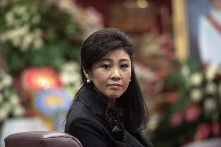 Ousted Thai prime minister Yingluck Shinawatra at a funeral in a Buddhist temple in Bangkok. The Red Shirts backed her toppled government (AFP Photo/Nicolas Asfouri)