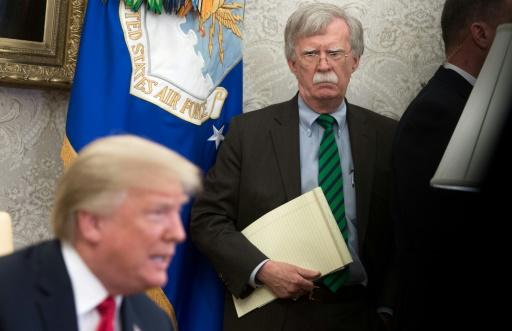 National Security Adviser John Bolton stands alongside US President Donald Trump as he speaks about the prospects for the summit with North Korea going ahead -- a meeting put in doubt when Pyongyang bristled at comments made by Bolton