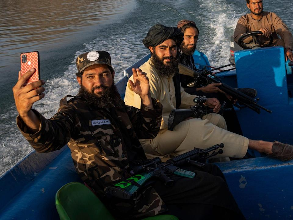 Taliban fighters take a selfie while enjoying a boat ride in Afghanistan