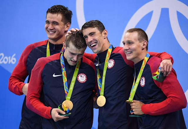 "<a class=""link rapid-noclick-resp"" href=""/olympics/rio-2016/a/1119837/"" data-ylk=""slk:Nathan Adrian"">Nathan Adrian</a>, Ryan Held, Michael Phelps and Caeleb Dressel pose with their medals. (Getty IMAGES)"