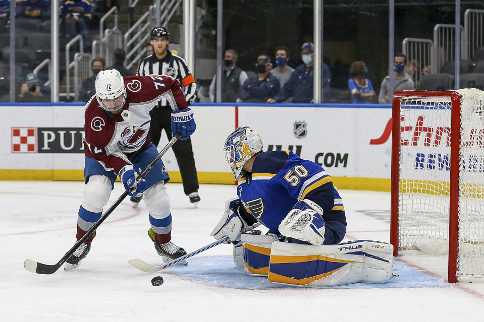 St. Louis Blues goaltender Jordan Binnington (50) stops Colorado Avalanche's Joonas Donskoi (72) from shooting during the third period in Game 3 of an NHL hockey Stanley Cup first-round playoff series Friday, May 21, 2021, in St. Louis. (AP Photo/Scott Kane)