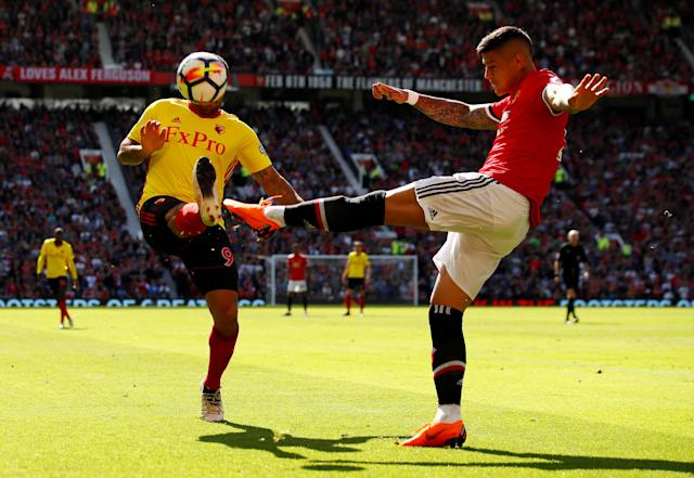 "Soccer Football - Premier League - Manchester United vs Watford - Old Trafford, Manchester, Britain - May 13, 2018 Manchester United's Marcos Rojo in action with Watford's Troy Deeney Action Images via Reuters/Jason Cairnduff EDITORIAL USE ONLY. No use with unauthorized audio, video, data, fixture lists, club/league logos or ""live"" services. Online in-match use limited to 75 images, no video emulation. No use in betting, games or single club/league/player publications. Please contact your account representative for further details. TPX IMAGES OF THE DAY"