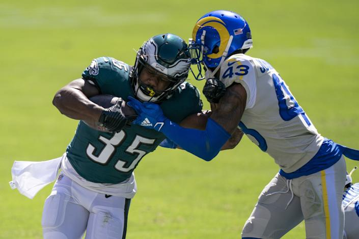 Eagles running back Boston Scott (35) is tackled by safety John Johnson.