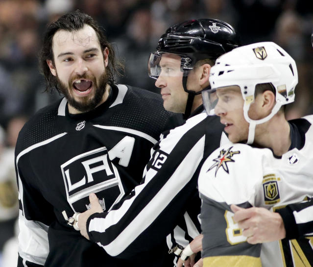 Los Angeles Kings defenseman Drew Doughty reacts after getting hit with a stick by Vegas Golden Knights center Jonathan Marchessault during the second period of Game 3 of an NHL hockey first-round playoff series in Los Angeles, Sunday, April 15, 2018. (AP Photo/Chris Carlson)