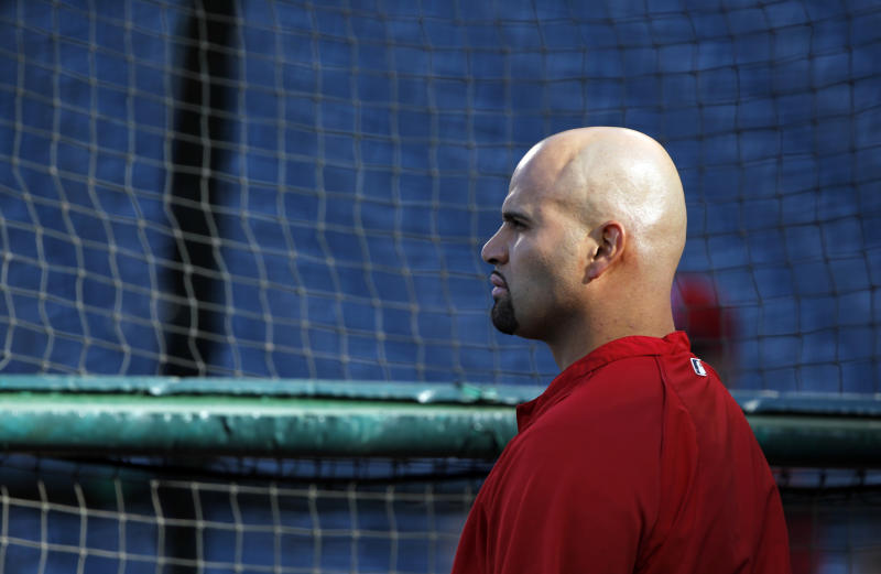 File-This April 19, 2013 file photo shows Los Angeles Angels first baseman Albert Pujols at the batting cage in Anaheim. Pujols is done for the season because of an injured left foot. The Angels made the announcement Monday Aug. 19, 2013, before playing Cleveland. Pujols hasn't played since July 26. He had been saying he wanted to return when his partially torn plantar fascia healed. (AP Photo/Alex Gallardo, File)