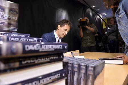 Lagercrantz signs his book at a release event for the fourth book in the Millennium series of crime novels in Stockholm