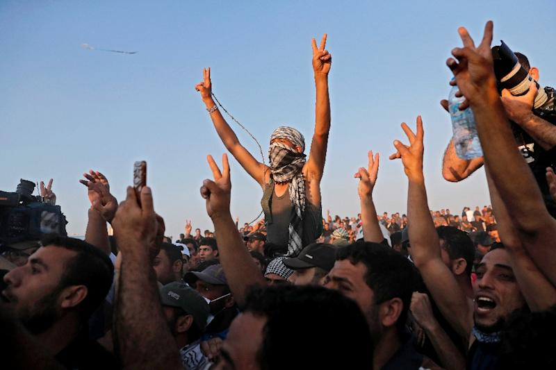 Supporters of Hamas leader Ismail Haniya react during his speech near the border with Israel east of Gaza City on May 15, 2018 (AFP Photo/THOMAS COEX)