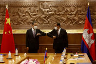 Chinese Foreign Minister Wang Yi, left, greets with Cambodian counterpart Prak Sokhonn in Phnom Penh, Cambodia, Sunday, Sept. 12, 2021. Wang is visiting Cambodia, where's he expected to meet with Prime Minister Hun Sen and other officials to discuss COVID-19 and other regional issues. (Kith Serey/Photo Photo via AP)