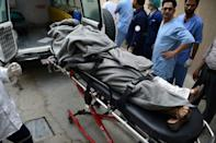 A dead woman is brought to a morgue at the Wazir Akbar Khan hospital in Kabul after the attack which, an Afghanistan health ministry spokesman said, killed at least two people and wounded 25