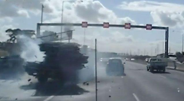 The driver's cabin manages to avoid the stationary truck, but his load follows through and slams into it. Source: 7 News