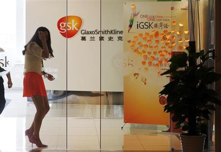 An employee walks inside a GlaxoSmithKline office in Shanghai