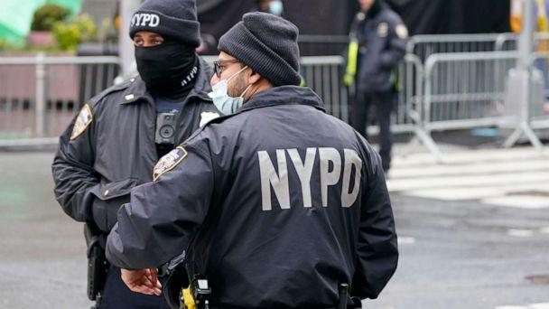 PHOTO: New York Police officers wear protective masks during the coronavirus pandemic in Times Square, Dec. 31, 2020, in New York. (Frank Franklin II/AP, FILE)