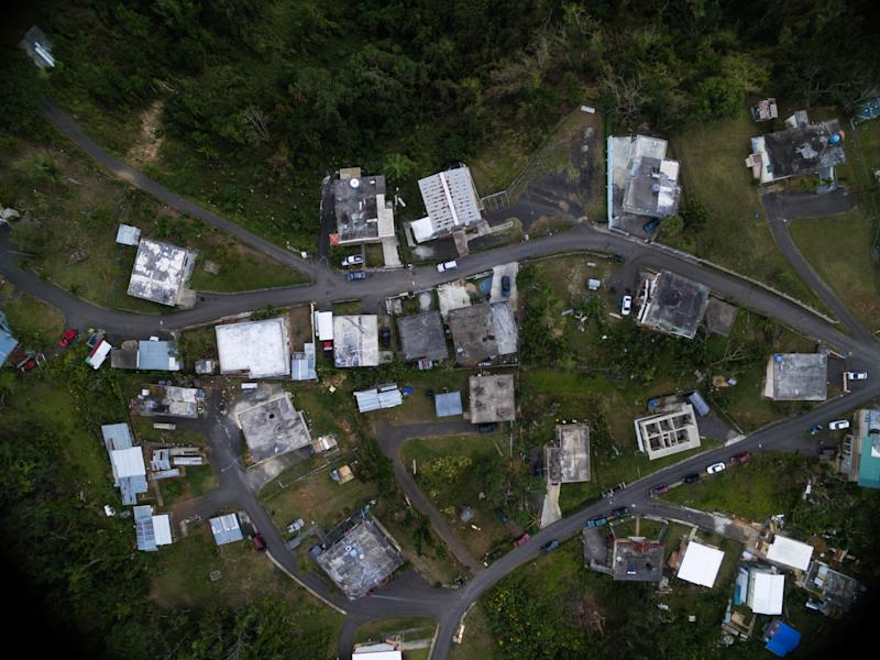 An overhead view of one of the communities Iniciativas De Paz serves reveals that some houses are entirely without roofs, and others are still making do with the tarp roofs installed by FEMA. (Alexis Fairbanks)