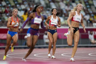 Katarina Johnson-Thompson, of Britain, reacts during a heat in the heptathlon women's 200-meter at the 2020 Summer Olympics, Wednesday, Aug. 4, 2021, in Tokyo. (AP Photo/Martin Meissner)