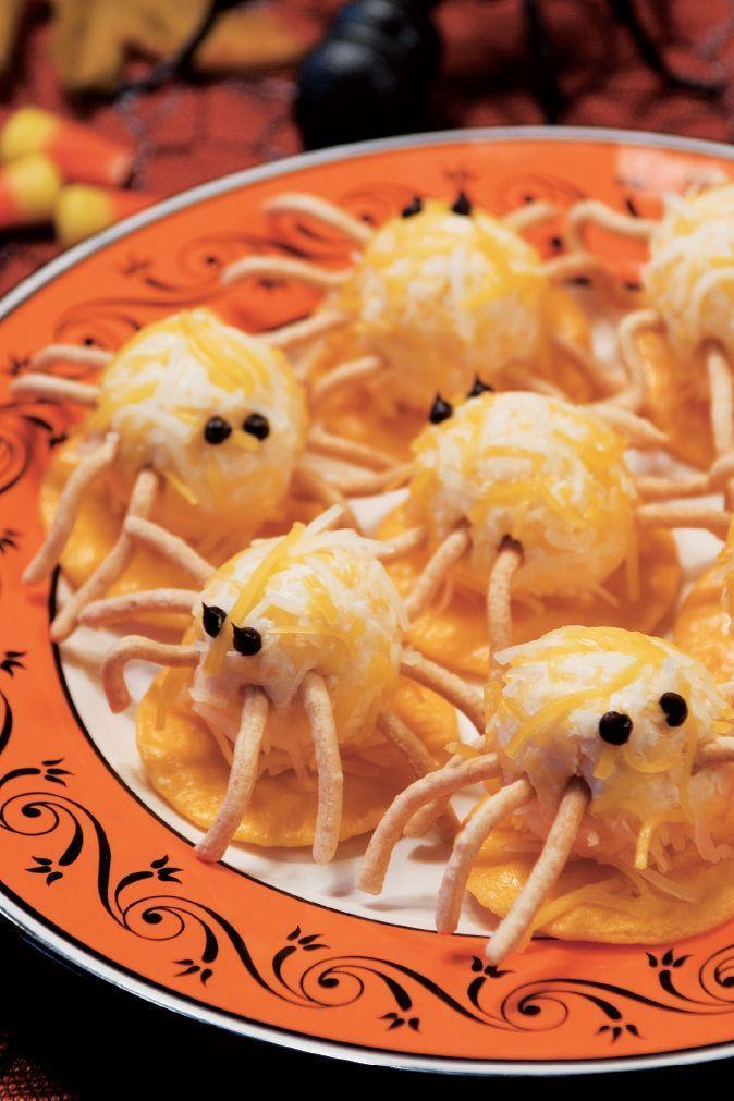 """<p>Cream cheese and shredded cheese come together to make these little critters, complete with chow mein noodle legs.</p><p><em><strong><a href=""""https://www.womansday.com/food-recipes/food-drinks/a28859367/cheesy-spiders-recipe/"""" rel=""""nofollow noopener"""" target=""""_blank"""" data-ylk=""""slk:Get the Cheesy Spiders recipe."""" class=""""link rapid-noclick-resp"""">Get the Cheesy Spiders recipe.</a></strong></em></p>"""