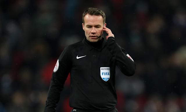 Paul Tierney in familiar pose during the Tottenham-Rochdale FA Cup replay on Wednesday, with his finger in his ear waiting for a VAR decision.