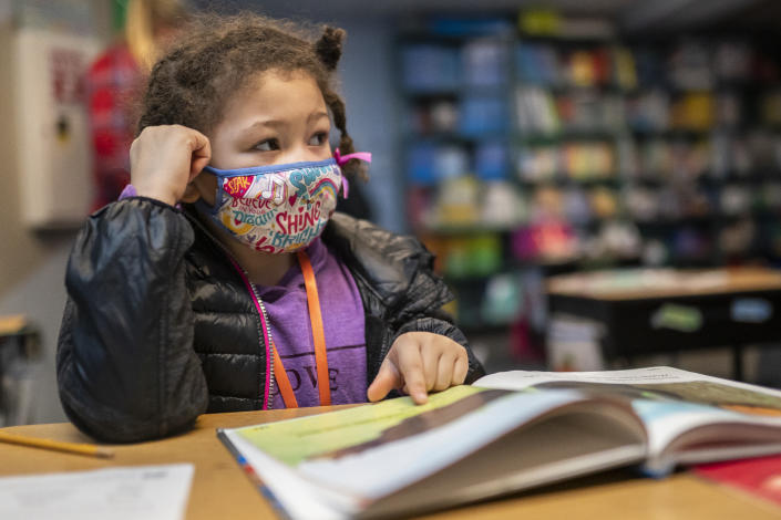 WOODLAND, WA - FEBRUARY 18: A first grade student at the Green Mountain School listens to her teacher on February 18, 2021 in Woodland, Washington. Washington state loosened in-person learning guidelines in December, sending elementary and middle school students back to the classroom a few days each week. (Photo by Nathan Howard/Getty Images)