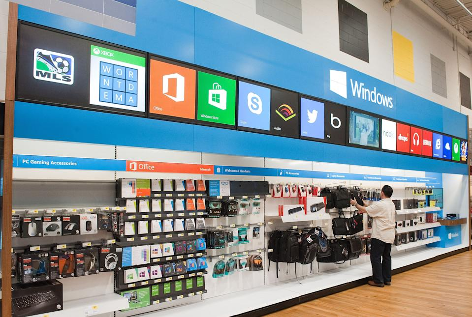 <p> This undated photo provided by Microsoft, shows windows store at Best Buy. Best Buy announced Thursday, June 13, 2013, it is partnering with Microsoft to feature a store-within-a-store for its Windows products, the latest major consumer electronics retailer to acknowledge advantages of the brick-and-mortar format (AP Photo/Microsoft Corp)</p>